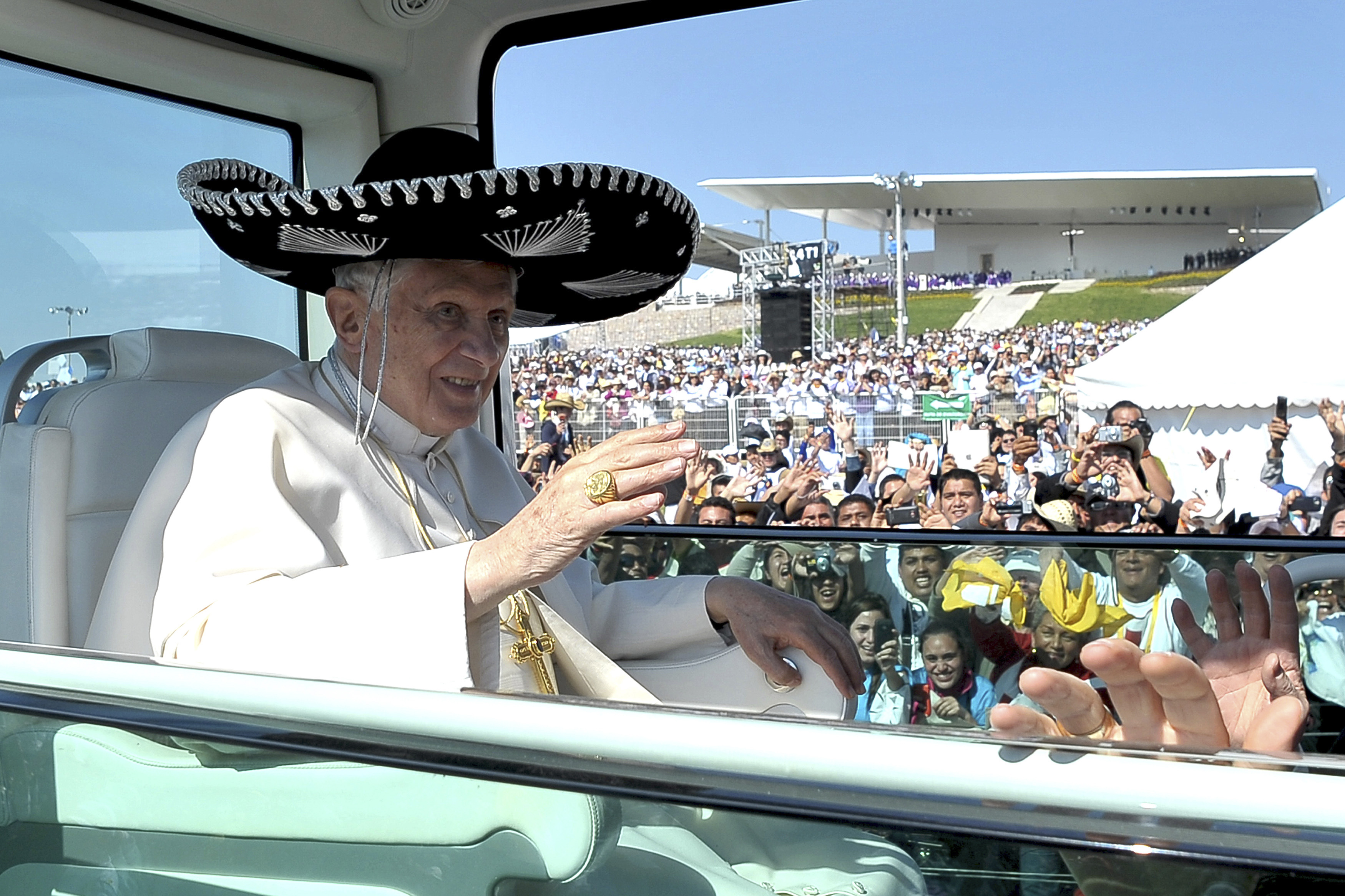 Pope Benedict XVI wears a sombrero, a traditional Mexican hat, while being driven through the crowd before officiating a mass in Silao March 25, 2012. REUTERS/Osservatore Romano (MEXICO - Tags: RELIGION TPX IMAGES OF THE DAY SOCIETY) FOR EDITORIAL USE ONLY. NOT FOR SALE FOR MARKETING OR ADVERTISING CAMPAIGNS. THIS IMAGE HAS BEEN SUPPLIED BY A THIRD PARTY. IT IS DISTRIBUTED, EXACTLY AS RECEIVED BY REUTERS, AS A SERVICE TO CLIENTS