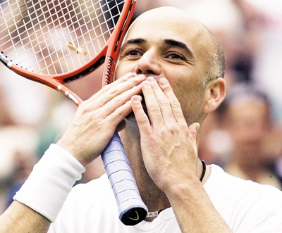 Andre Agassi blows a kiss to the crowd, after defeating Boris Pashanski of Serbia, in their Men's Singles, first round match on the Centre Court at Wimbledon, Tuesday June 27, 2006.(AP Photo/Anja Niedringhaus)